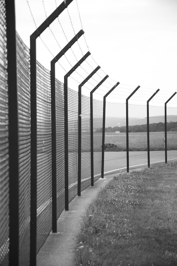 high fence with barb wire